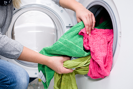 image of laundry getting done by a home caregiver at the Dorchester Seniors Center in Summerville, SC